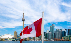 TORONTO, ONTARIO, CANADA - 2016/05/10: Canadian flag and the Toronto skyline. The flags waves from the back of a tourist cruise in Lake Ontario. (Photo by Roberto Machado Noa/LightRocket via Getty Images)
